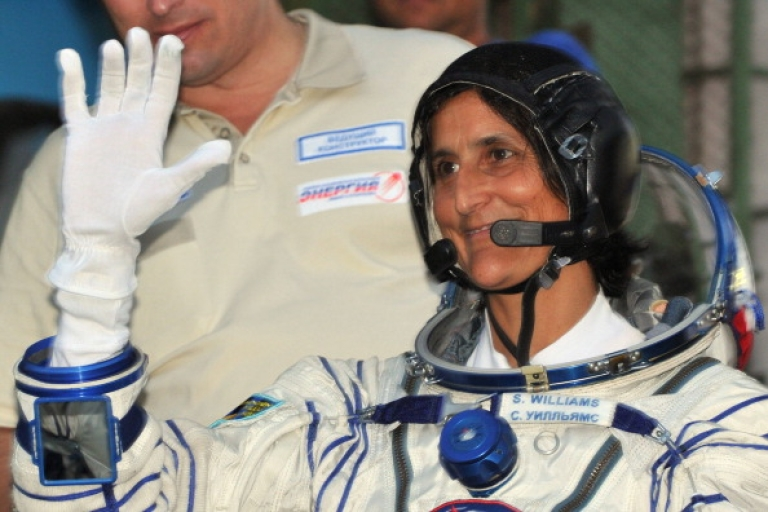 <p>Astronaut Sunita Williams of the US gestures before boarding the Soyuz TMA-05M spacecraft at the Russian-leased Baikonur cosmodrome on July 15, 2012.</p>
