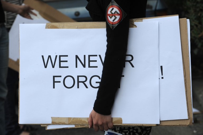 <p>A protestor wearing a