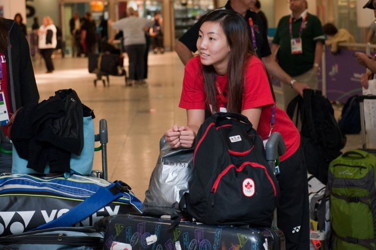 <p>A member of the Canadian Olympic badminton team arrives at Heathrow airport in London on July 17, 2012 as officials and athletes arrive in the capital for the London 2012 Olympic Games that start on July 27.</p>