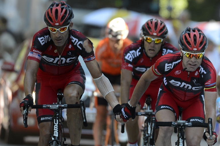 <p>Tour de France 2011 winner, Australia's Cadel Evans (R) crosses the finish line with teammate, US George Hincapie (L) at the end of the197 km and sixteenth stage of the 2012 Tour de France cycling race starting in Pau and finishing in Bagneres de Luchon, southern France, on July 18, 2012.</p>