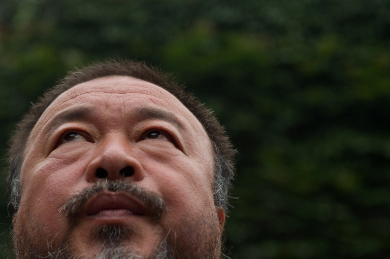 <p>Chinese artist Ai Weiwei speaks to the media inside his compound in Beijing as the verdict of his court hearing is announced on July 20, 2012. Ai Weiwei lost his appeal against a multi-million-dollar tax fine on a company he founded, his lawyer said.</p>