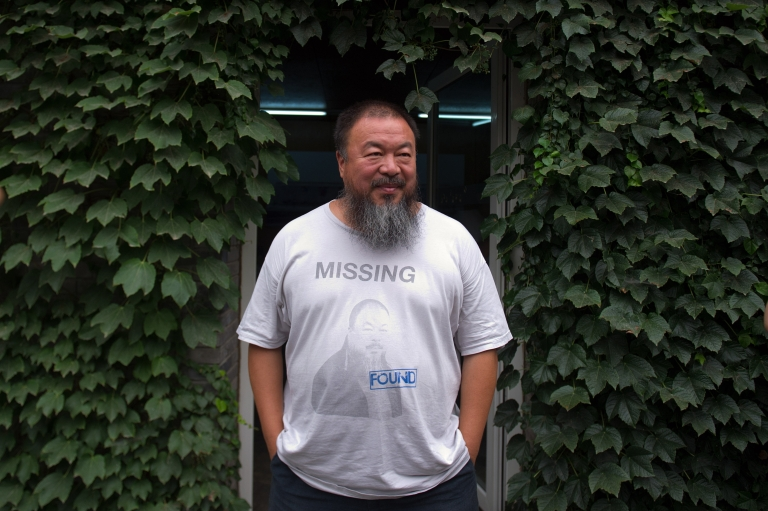 <p>Chinese artist Ai Weiwei waits for his lawyer to return from a court hearing at his compound in Beijing on July 20, 2012.</p>