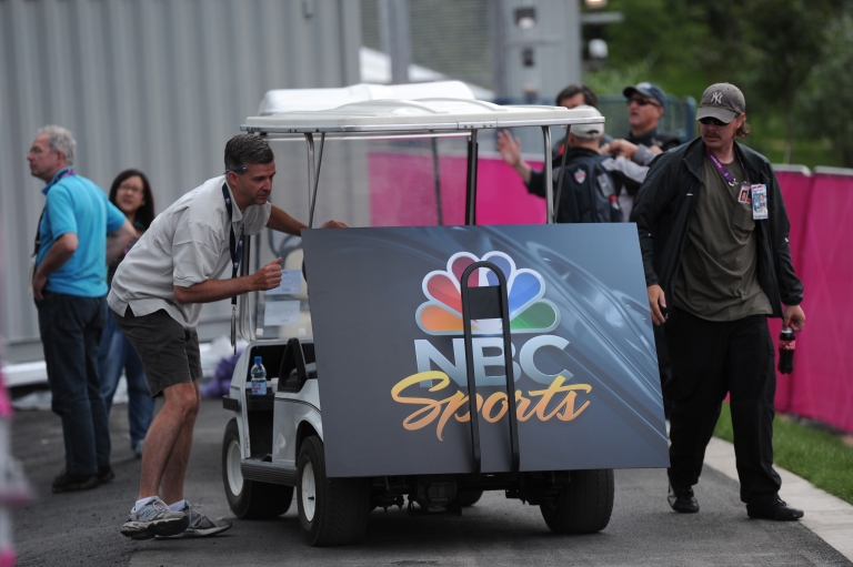 <p>An NBC Sports poster board is unloaded from a buggy at the London 2012 Olympic Park, east London, on July 21, 2012. The London 2012 Olympic Games begin on July 27, 2012.</p>