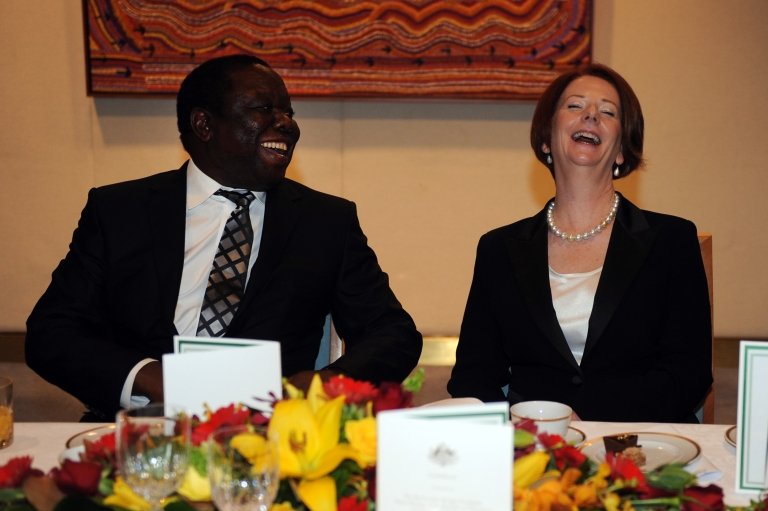 <p>Australian Prime Minister Julia Gillard laughs with the Prime Minister of Zimbabwe Morgan Tsangviri during a lunch in Canberra, Monday, July 23, 2012.</p>