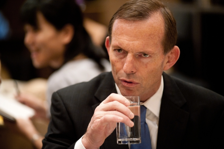 <p>Australian opposition leader Tony Abbott listens to his guests at a breakfast meeting hosted by the China-Australia Chamber of Commerce in Beijing on July 24, 2012.</p>