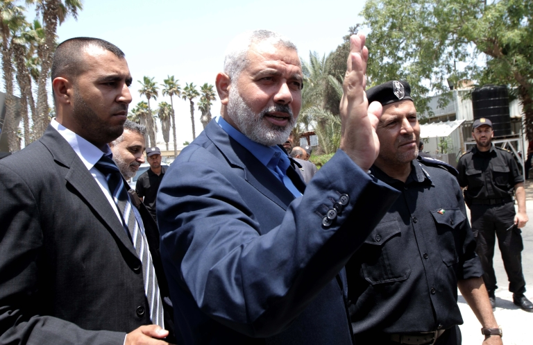 <p>Palestinian Hamas premier in the Gaza Strip Ismail Haniya is pictured upon his arrival to the Rafah border crossing in the southern Gaza Strip on July 25, 2012 following a visit to Egypt.</p>