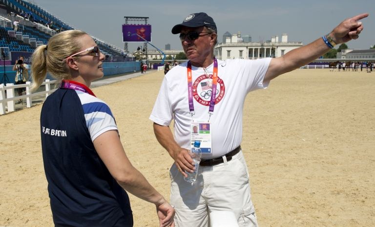 <p>Britain's eventing individual champion and granddaughter of Queen Elizabeth II, Zara Phillips (L) chats with her father and coach of the US eventing team, Mark Phillips at the Equestrian arena in Greenwich, London, on July 25, 2012, two days before the start of the London 2012 Olympic Games.</p>