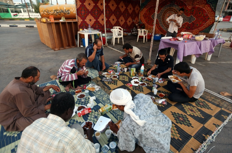 <p>Libyans break their fast at the end of the sixth day of Islam's holy month of Ramadan, in Tripoli, on July 25, 2012.</p>