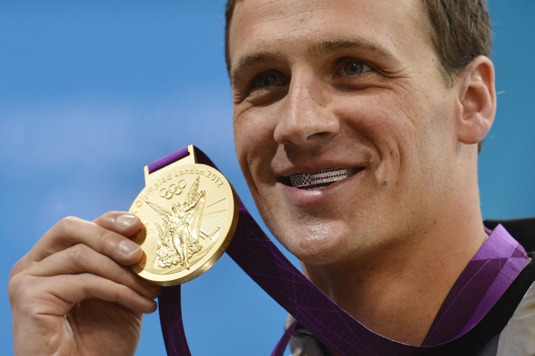 <p>Ryan Lochte initially wearing his grill, before IOC members asked him to remove it.</p>