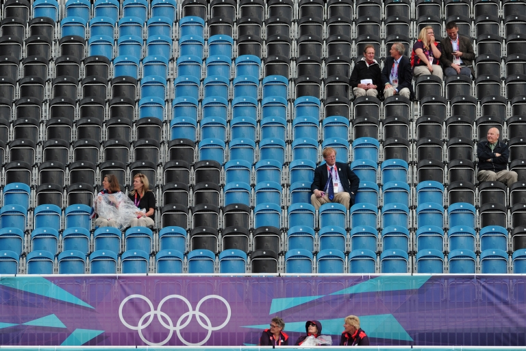 <p>Empty seats and spectators are pictured during in the dressage event of the equestrian eventing competition at the London 2012 Olympic Games in Greenwich Park, London, on July 29, 2012.</p>