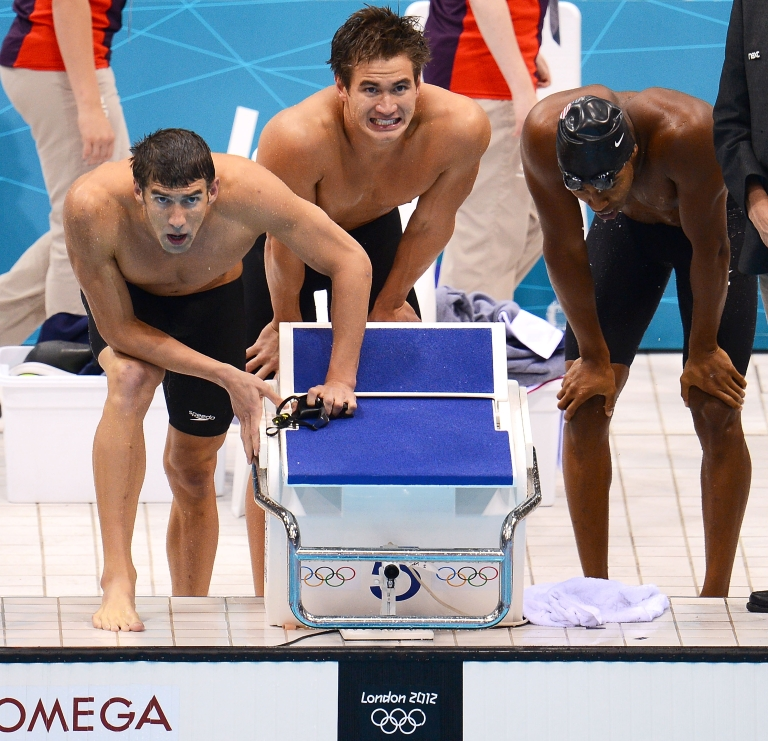 <p>(L-R) Michael Phelps, Nathan Adrian and Cullen Jones of the United States cheer on their teammate during the Men's 4 x 100m Freestyle Relay final on Day 2 of the London 2012 Olympic Games at the Aquatics Centre on July 29, 2012 in London, England.</p>