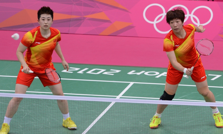 <p>Wang Xiaoli (R) and Yu Yang (L) play a shot during their women's double badminton match against Kim Ha Na and Jung Kyung Eun of South Korea during the London 2012 Olympic Games.</p>