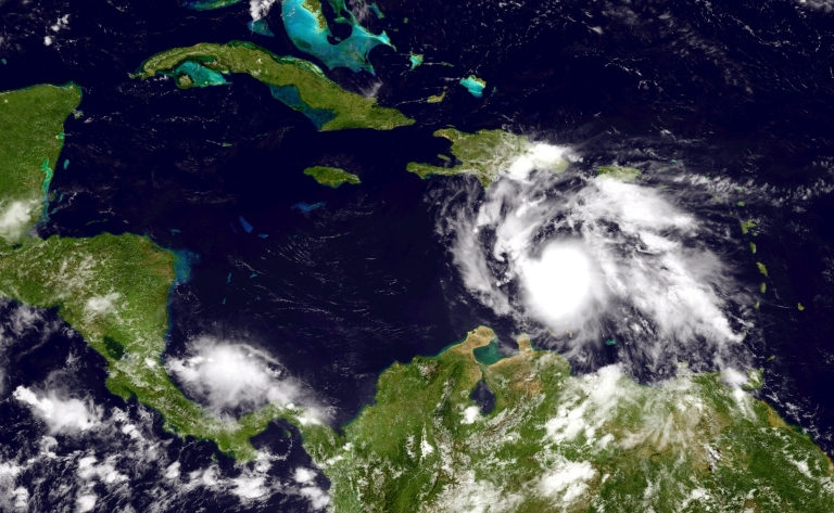 <p>A handout photo provided by the National Oceanic and Atmospheric Administration (NOAA) shows Tropical Storm Ernesto building strength as it moves west toward Jamaica Aug. 4 in the Caribbean.</p>