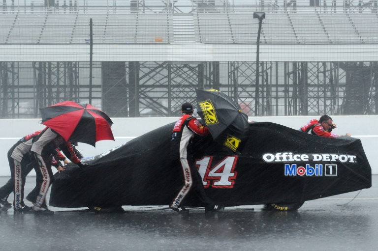 <p>Crew members push the #14 Office Depot Back to School Chevrolet, driven by Tony Stewart, back to the garage as rain falls during the NASCAR Sprint Cup Series Pennsylvania 400.</p>