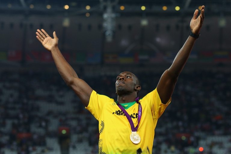 <p>Gold medalist Usain Bolt of Jamaica celebrates on the podium during the medal ceremony for the men's 200m at the London 2012 Olympic Games on August 9, 2012 in England.</p>