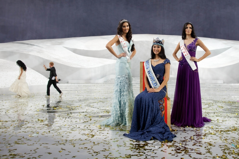 <p>Miss World 2012 winner Yu Wenxia (C) of China, second place contestant Miss Wales Sophie Moulds (L) and third place Miss Australia Jessica Kahawaty (R) pose for photos following the pageant's final ceremony at the Ordos Stadium Arena in the inner Mongolian city of Ordos on August 18, 2012.</p>