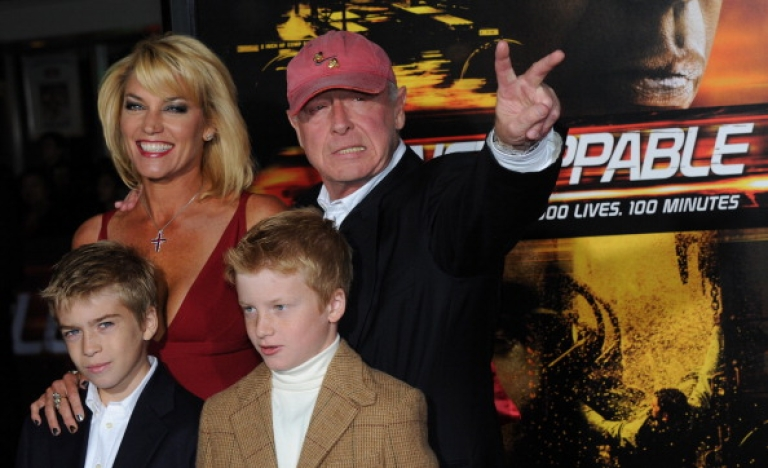 <p>British director Tony Scott arriving with his family on the red carpet for the premiere of the film 'Unstoppable' at the Regency Village Theater in Los Angeles on October 26, 2010.</p>