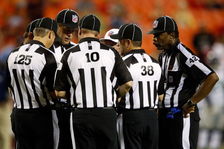 <p>Referees huddle in conference during the NFL preseason game between the Seattle Seahawks and the Kansas City Chiefs at Arrowhead Stadium on August 24, 2012 in Kansas City, Missouri.</p>