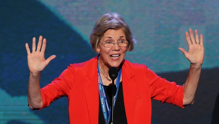 <p>Massachusetts Senate candidate Elizabeth Warren stands at the podium on stage during a walkthrough during day one of the Democratic National Convention at Time Warner Cable Arena on September 4, 2012 in Charlotte, North Carolina.</p>