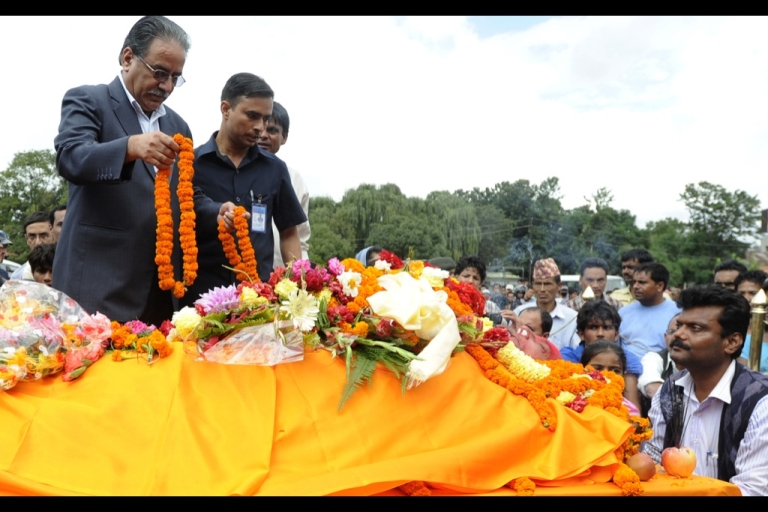 <p>Unified Communist Party of Nepal (Maoist) chairman, Pushpa Kamal Dahal (R), also known as 'Prachanda' pays respects to controversial politician Ramraja Prasad Singh in Kathmandu on September 12, 2012.</p>