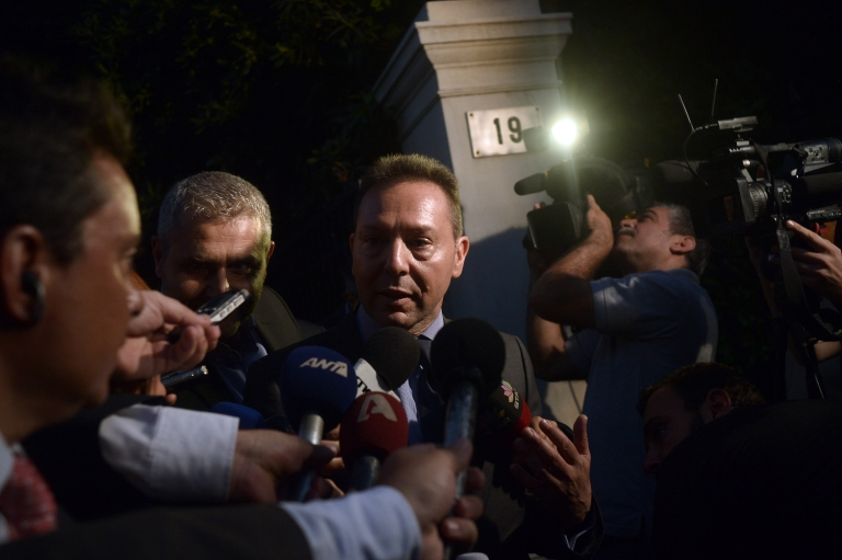 <p>Greek Finance Minister Yannis Stournaras leaves the Prime Minister's office after a meeting with the IMF and EC officials in Athens on October 1, 2012.</p>