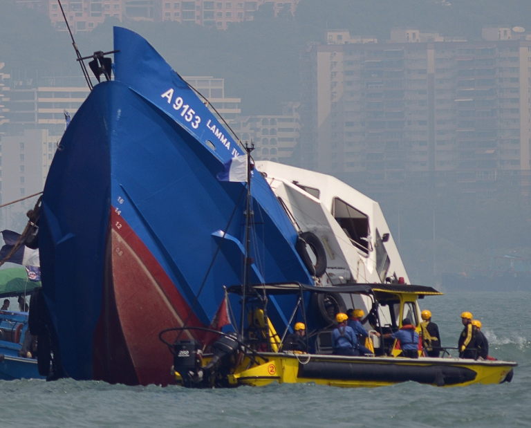 <p>The bow of the Lamma IV boat (L) is seen partially submerged during rescue operations on October 2, 2012 the morning after it collided with a Hong Kong ferry killing over 30 people.</p>