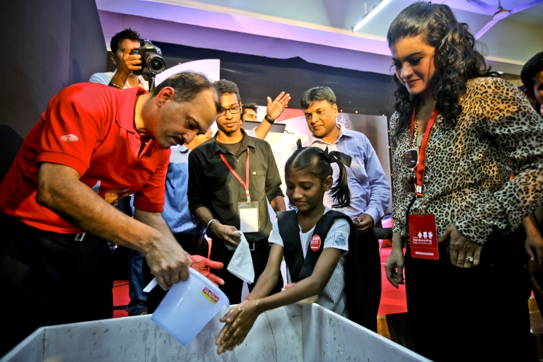 <p>MUMBAI, INDIA - OCTOBER 15: CEO &amp; MD of Unilever India, Nitin Paranjpe (L) and Bollywood movie actress, Kajol (R) attend a Global Handwashing Day event at Worli Seaface Mumbai Municipal Corporation School on October 15, 2012 in Mumbai, India.</p>