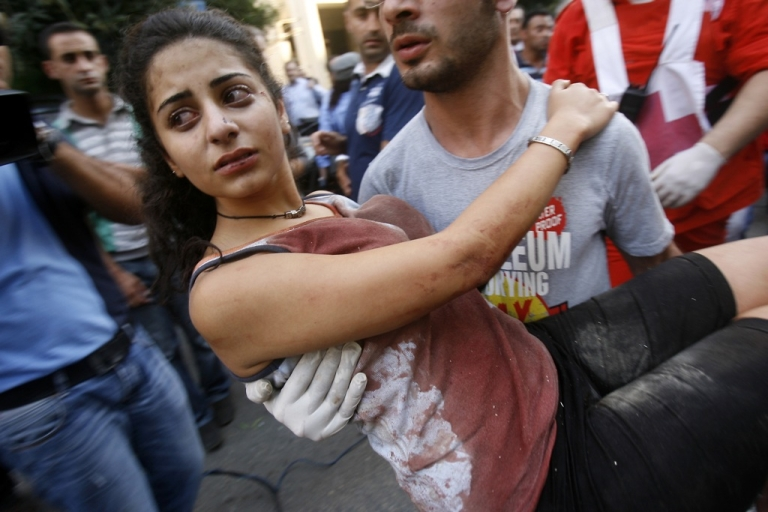 <p>A Lebanese man evacuates a wounded woman from the site of the explosion, Sassine Square in the heart of east Beirut's Ashrafiya district.</p>