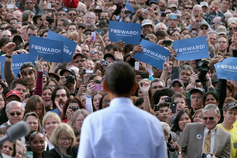<p>Obama shows off his new campaign slogan in Nashua, New Hampshire.</p>