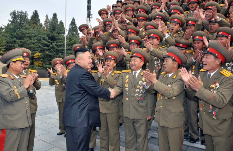 <p>This picture, taken by North Korea's official Korean Central News Agency on October 29, 2012 shows North Korean leader Kim Jong Un (2nd L) being greeted at the 60th anniversary of the Kim Il Sung Military University as the statues of the country's late leaders Kim Il Sung and Kim Jong Il were erected at the university in Pyongyang.</p>