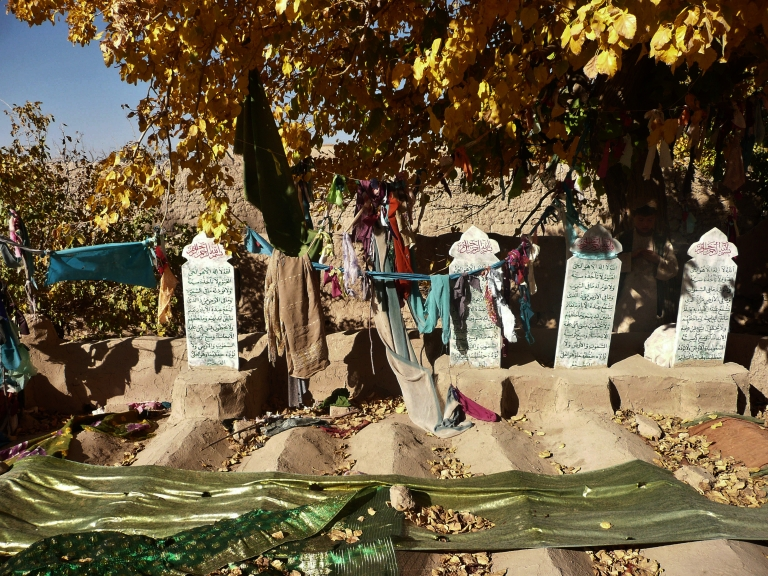 <p>Grave stones of some of the sixteen Afghan villagers who were killed in the March massacre are pictured in the grave-yard in Panjwai district of Kandahar province on November 4, 2012.</p>