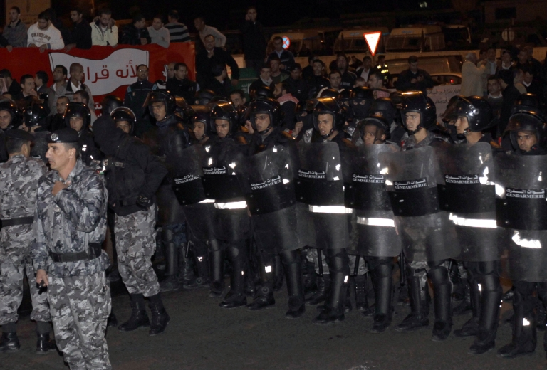 <p>Jordanian policemen stand guard during a demonstration in Amman following an announcement that Jordan would raise fuel prices, including a 53 percent hike on cooking gas, on November 13, 2012.</p>
