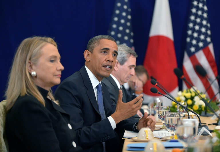 <p>US Secretary of State Hillary Clinton (L) listens as US President Barack Obama (C) speaks during a bilateral meeting with Japan's Prime Minister Yoshihiko Noda (not pictured) on the sidelines of the East Asian Summit at the Peace Palace in Phnom Penh on November 20, 2012.</p>