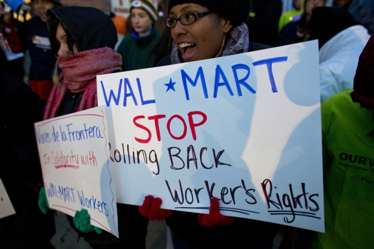 <p>Workers and supporters march outside a local Walmart on November 23, 2012, in Milwaukee, Wisconsin. The protesters were calling for better wages and working conditions for the employees.</p>