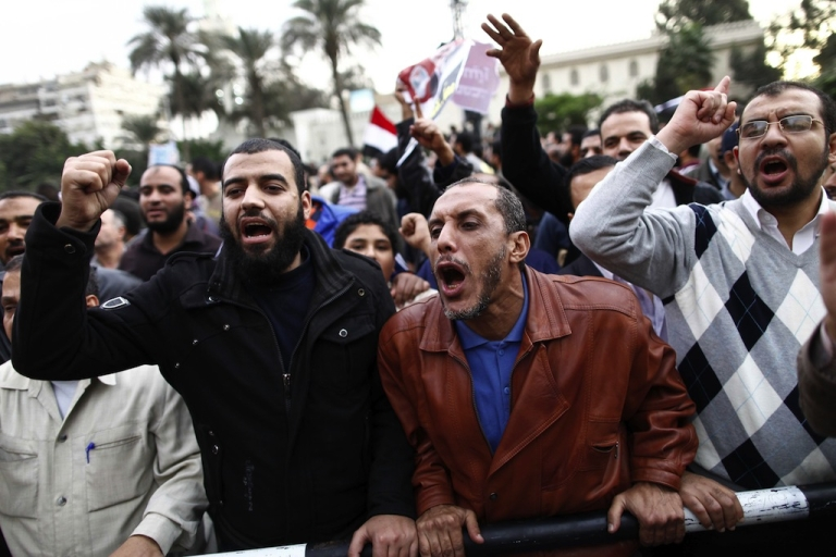 <p>Demonstrators shout slogans outside the Egyptian presidential palace in Cairo on December 5, 2012. Three of Egyptian President Mohamed Morsi's advisers have resigned, state media said, as clashes raged outside the presidential palace over his expanded powers and a disputed draft constitution.</p>
