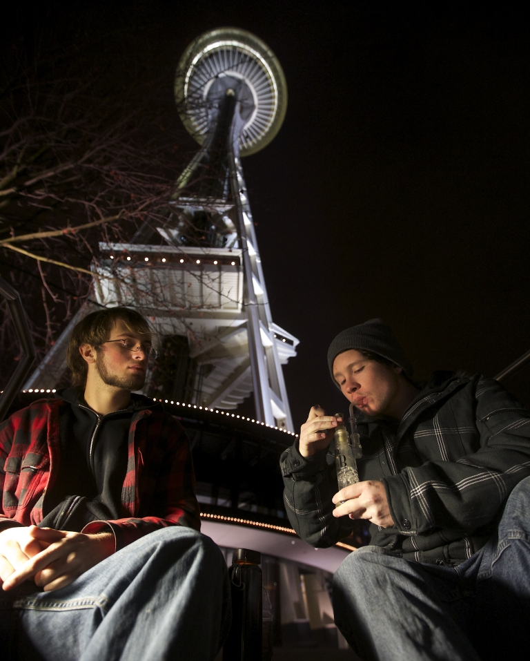 <p>Dustin, left, and Paul of Tacoma, Washington, both of which declined to give their last names, share a water pip underneath the Space Needle shortly after a law legalizing the recreational use of marijuana took effect on December 6, 2012 in Seattle, Washington.</p>