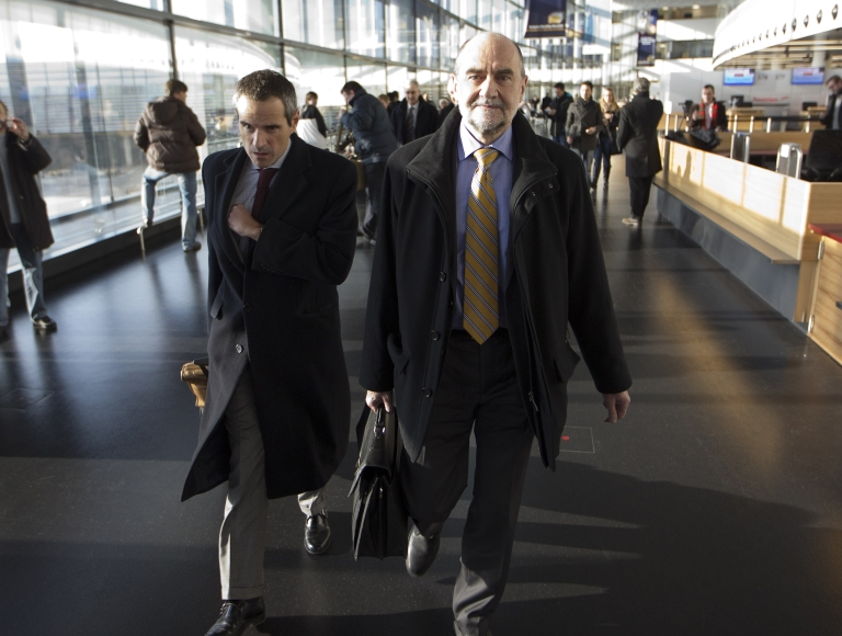 <p>IAEA (International Atomic Energy Agency) Deputy Director General and Head of the Department of Safeguards Herman M.G. Nackaerts (R) and his team leave on another trip to Iran on December 12, 2012 at Schwechat Airport, near Vienna.</p>