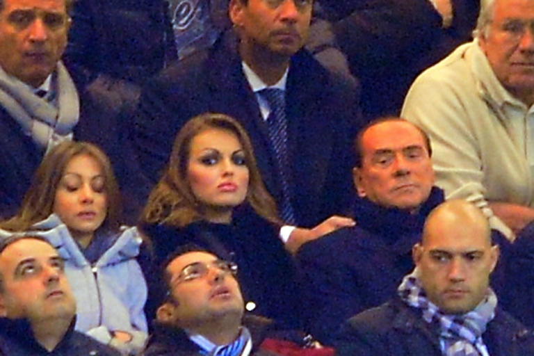<p>In this picture taken on December 4, 2012 AC Milan's president Silvio Berlusconi (R) sits with his fiancee Francesca Pascale (L) during the Champions League match AC Milan vs FC Zenith at the at San Siro Stadium in Milan.</p>