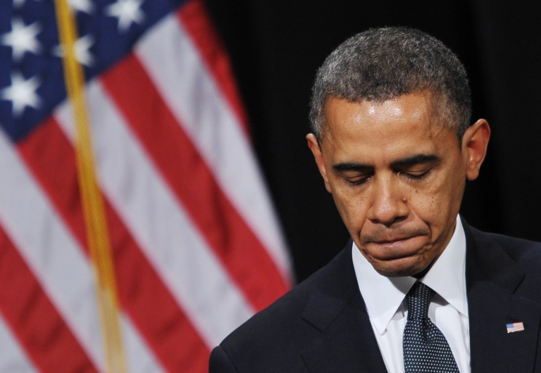 <p>US President Barack Obama pauses as he speaks during a memorial service for the victims and relatives of the Sandy Hook Elementary School shooting on December 16, 2012 in Newtown, Connecticut.</p>