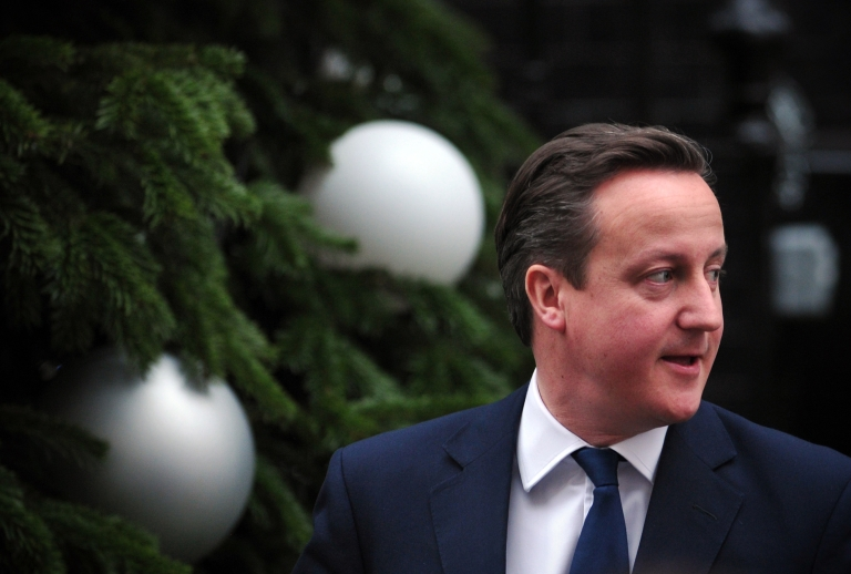<p>British Prime Minster David Cameron leaves 10 Downing Street in central London on December 19, 2012, for the weekly Prime Minister's question session in the House of Commons.</p>
