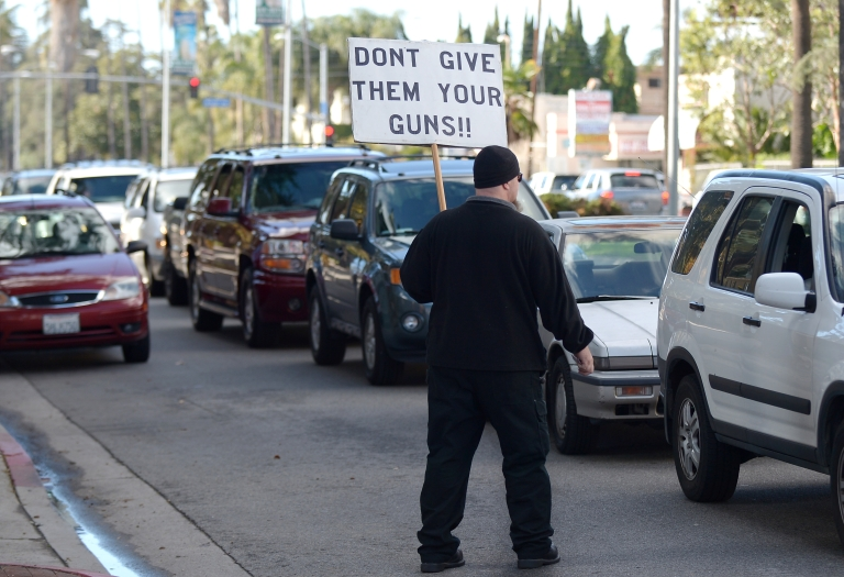 <p>One of two pro-gun activists protests against the Gun Buyback Program organized in the traditionally liberal Los Angeles during the LAPD Gun Buyback Program event in the Van Nuys area of north Los Angeles on December 26, 2012.</p>
