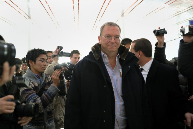 <p>Google Executive Chairman Eric Schimidt (C) makes his way after checking in at Beijing International airport in Beijing on January 7, 2013, before his trip to North Korea.</p>
