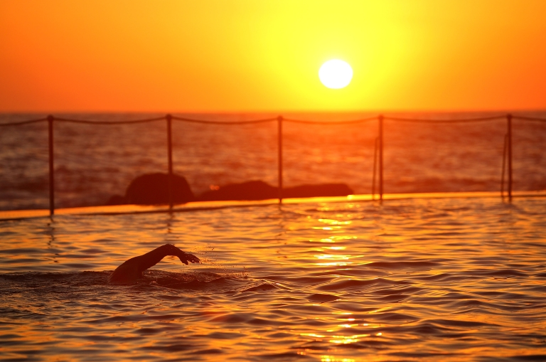 <p>Sunrise swimmers take to Bronte Pool in Bronte Beach to beat the heat as temperatures are expected to reach record highs today on January 8, 2013 in Sydney, Australia.</p>