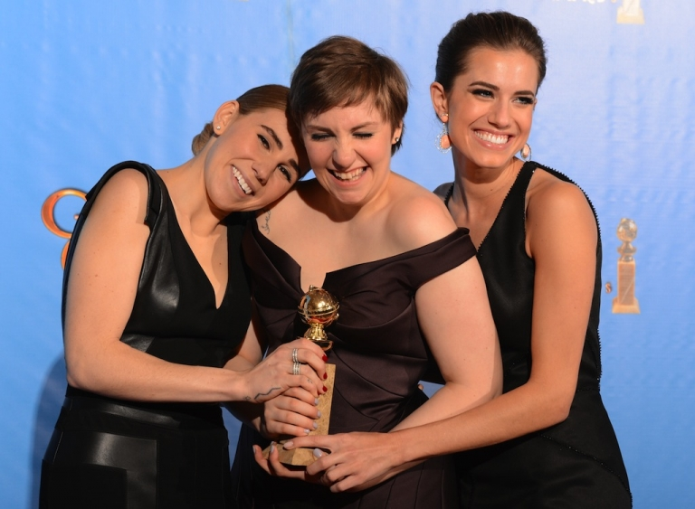 <p>Lena Dunham (C) poses in the press room with her award for