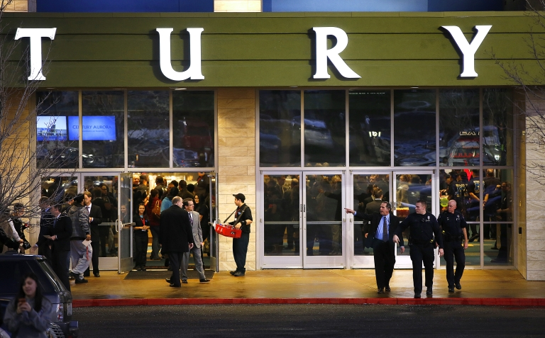 <p>Invited guests make their way into a reopening ceremony and evening of remembrance at the Cinemark Century 16 Theaters in Aurora, Colorado on January 17, 2013. The theater was the site of of a mass shooting in July 2012 that killed 12 people and wounded dozens of others.</p>