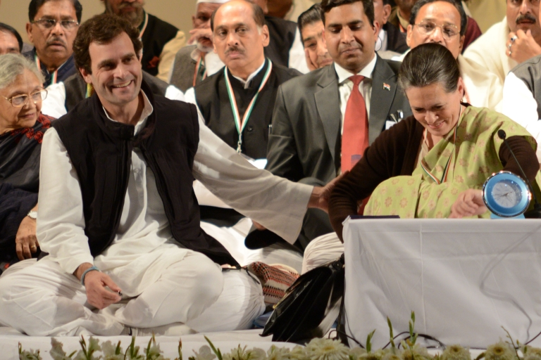 <p>Congress party Vice-President Rahul Gandhi (L) gestures as he shares a light moment with his mother, Congress Party President Sonia Gandhi (R), during the Congress party leadership conclave in Jaipur on January 20, 2013.</p>