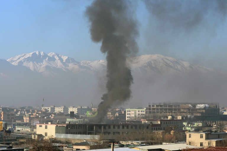 <p>Black smoke billows from the Afghan police headquarters during an attack in Kabul on January 21, 2013. NATO troops joined a fight against a Taliban suicide squad that stormed a Kabul police headquarters on Monday, unleashing a stand-off that lasted for more than five hours.</p>