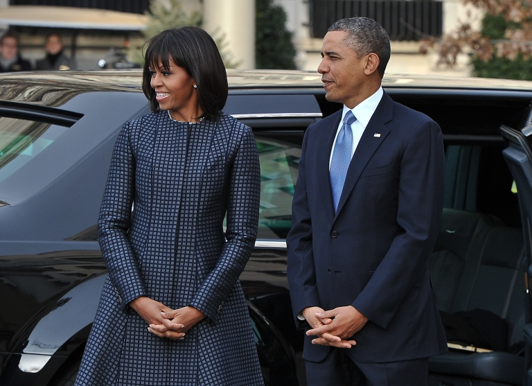 <p>US President Barack Obama and First Lady Michelle Obama arrive at St. John's Church on January 21, 2013 in Washington, DC, hours before Obama participates in a ceremonial swearing in for a second term in office</p>