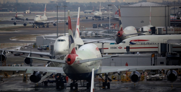 <p>British Airways planes are docked at Terminal 5 Heathrow airport in west London on January 21, 2013 after the airport announced further flight cancellations due to adverse weather.</p>
