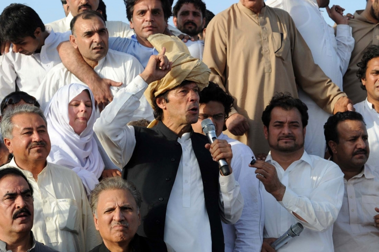 <p>Pakistani politician Imran Khan addresses a peace rally in Tank on October 7, 2012. Khan and his followers were stopped from entering Pakistan's tribal region after they bypassed road blocks to press towards the region to protest against US drone strikes.</p>